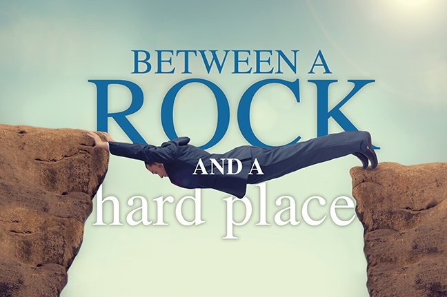 Image result for between a rock and a hard place